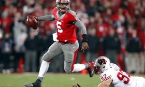 Ohio State Miller runs from Wisconsin Kelly during the fourth quarter of their NCAA football game in Columbus